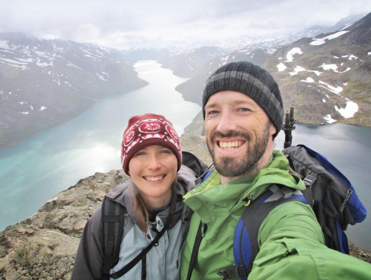 Couple selfie - tourists in Norway. Bessegen trail hike in Jotunheimen National Park.
